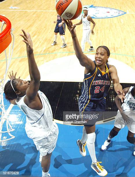 Tamika Catchings of the Indiana Fever puts up a shot against Nicky Anosike of the Minnesota Lynx during the game on June 6 2010 at the Target Center...