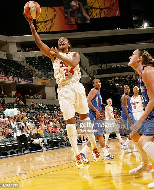 Tamika Catchings of the Indiana Fever puts up a shot against the New York Liberty at Conseco Fieldhouse on September 11 2008 in Indianapolis Indiana...