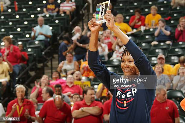 Tamika Catchings of the Indiana Fever receives the 2016 Kim Perrot Sportsmanship Award before the game against the Phoenix Mercury during Round One...