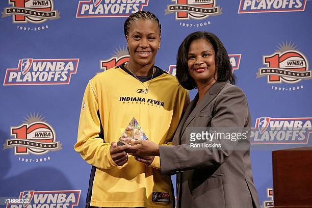 Tamika Catchings of the Indiana Fever receives the 'Defensive Player of the Year' award from WNBA Chief of Basketball Operations and Player Relations...