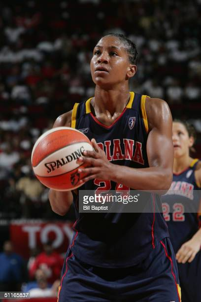 Tamika Catchings of the Indiana Fever shoots a free throw against the Houston Comets during their game on July 31 2004 at the Toyota Center in...