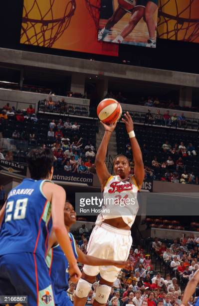 Tamika Catchings of the Indiana Fever shoots a jump shot during the WNBA game against the New York Liberty at Conseco Fieldhouse on July 10 2003 in...