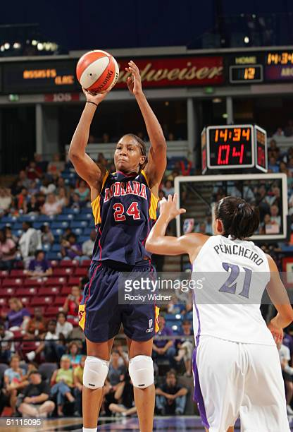 Tamika Catchings of the Indiana Fever shoots over Ticha Penicheiro of the Sacramento Monarchs July 25 2004 at Arco Arena in Sacramento California...