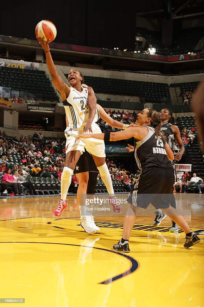 Tamika Catchings #24 of the Indiana Fever shots over Becky Hammon #25 of the San Antonio Silver Stars on May 13, 2013 at Bankers Life Fieldhouse in Indianapolis, Indiana.