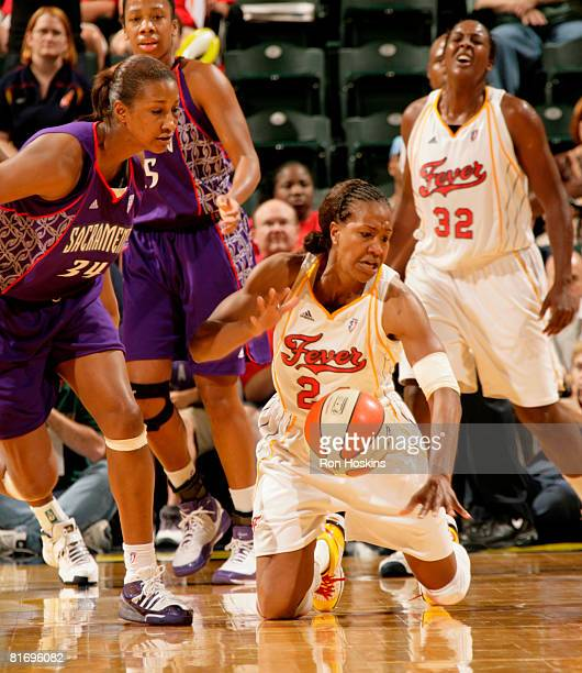 Tamika Catchings of the Indiana Fever steals the ball from Adrian WilliamsStrong of the Sacramento Monarchs at Conseco Fieldhouse June 24 2008 in...