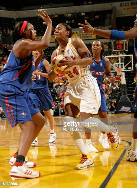 Tamika Catchings of the Indiana Fever takes on Kara Braxton of the Detroit Shock in Game One of the Eastern Conference Semifinals during the 2008...