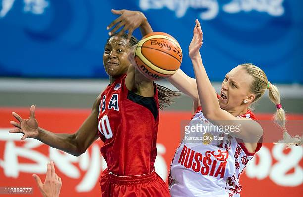Tamika Catchings of the United States battles Irina Osipova of Russia on Thursday August 21 in the Games of the XXIX Olympiad in Beijing China