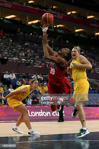 Tamika Catchings of United States drives for a shot attempt against Jenna O'Hea and Suzy Batkovic of Australia during the first half of the Women's...