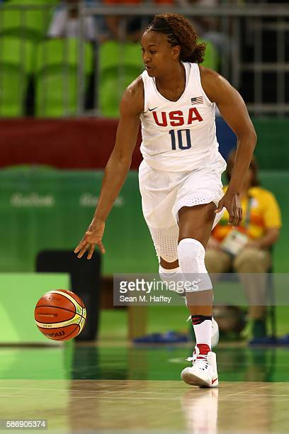 Tamika Catchings of United States moves the ball during a Women's Preliminary Round basketball game between the United States and Senegal on day 2 of...