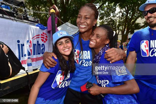 Tamika Catchings poses for a photo with Team South America Girls during the Jr NBA World Championship KaBOOM event in Orlando Florida at Oak Street...