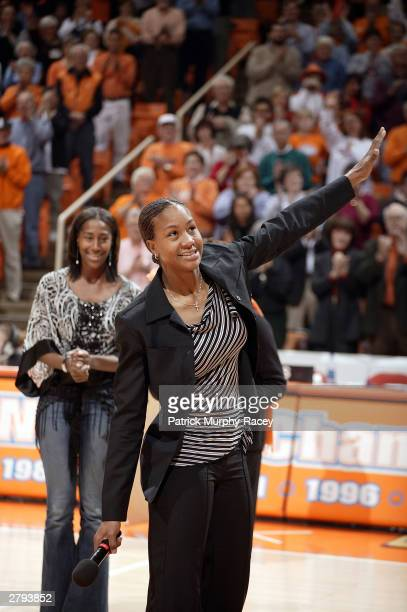 Tamika Catchings waves to the crowd during a halftime ceremony retiring her college jersey December 7 2003 at ThompsonBoling Arena in Knoxville...