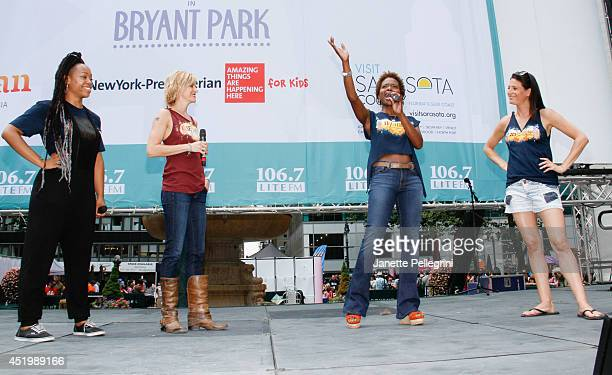 Tamika Lawrence Jenn Colella LaChanze and Jackie Burns from the cast of If/Then performs during 1067 LITE FM's Broadway in Bryant Park 2014 at Bryant...