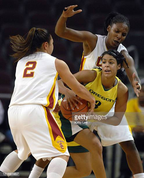 Tamika Nurse of Oregon is defended by Jamie Hagiya and Eshaya Murphy of Southern California during Pacific-10 Conference women's basketball game at...