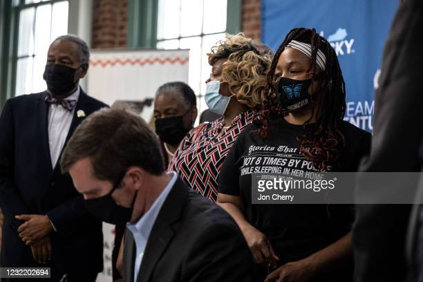 Tamika Palmer, Breonna Taylor's mother, cries and watches as Kentucky Gov. Andy Beshear signs SB4 into law at the Center for African American...