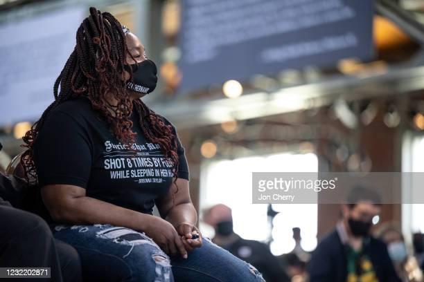 Tamika Palmer, Breonna Taylor's mother, watches and listens as Kentucky Gov. Andy Beshear speaks at the Center for African American Heritage during a...