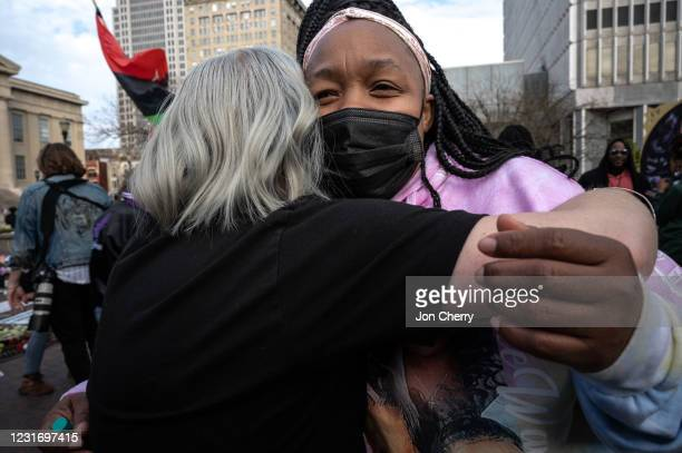 Tamika Palmer, mother of Breonna Taylor, hugs a protester in Jefferson Square Park on March 13, 2021 in Louisville, Kentucky. Today marks the one...