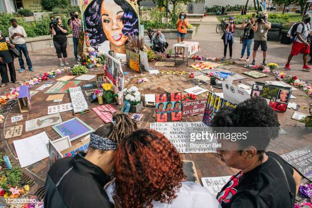 Tamika Palmer mother of Breonna Taylor is comforted as she looks over a memorial dedicated to her daughter on September 15 2020 in Louisville...