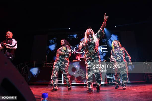 Tamika Scott LaTocha Scott and Tameka 'Tiny' Harris perform onstage during The Great Xscape tour at Philips Arena on December 31 2017 in Atlanta...