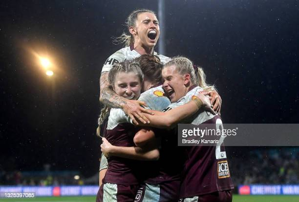Tamika Upton of Queensland celebrates with team mates during the Women's Rugby League State of Origin match at the Sunshine Coast Stadium on June 25,...