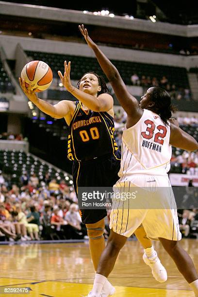Tamika Whitmore of the Connecticut Sun shoots around Ebony Hoffman of the Indiana Fever at Conseco Fieldhouse on August 28 2008 in Indianapolis...