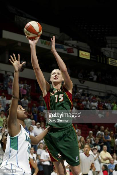 Tamika Williams of the Minnesota Lynx defends as Lauren Jackson of the Seattle Storm shoots short the jump shot during the WNBA game on August 2 2003...