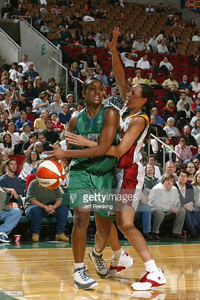 Tamika Williams of the Minnesota Lynx is defended by Adia Barnes of the Seattle Storm during the game at Key Arena in Seattle Washington on June 4...