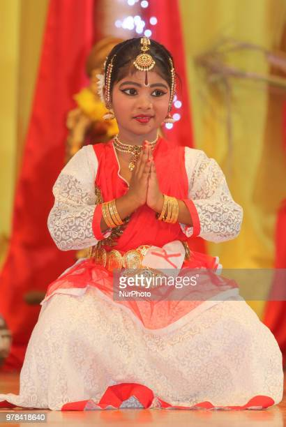 Tamil Bharatnatyam dancer performs a fusion dance mixing traditional styles with modern elements during a cultural program celebrating Tamil Heritage...