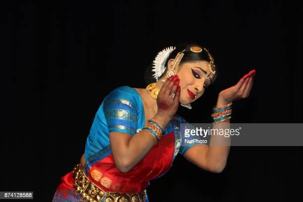 Tamil Bharatnatyam dancer performs an expressive dance during her Arangetram in Brampton Ontario Canada This dance is dedicated to the Hindu Goddess...