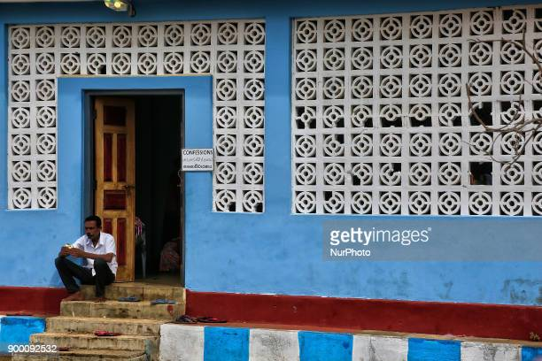 Tamil Catholic man sits on the steps of the confessional building after giving his confession at the Church of Our Lady of Madhu in Mannar Sri Lanka...