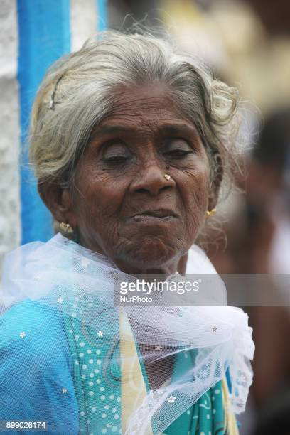 Tamil Catholic woman listens to prayers being recited at the Shrine of Our Lady of Madhu during the Feast of Our Lady of Madhu in Mannar Sri Lanka...