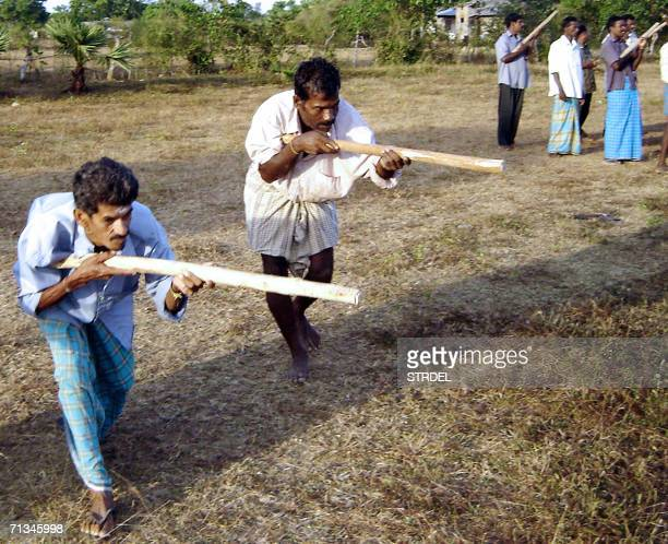 Tamil civilians get soldier training on the outskirts of Kilinochchi 328 kilometers north of the country's main city Colombo 30 June 2006 Sri Lankan...