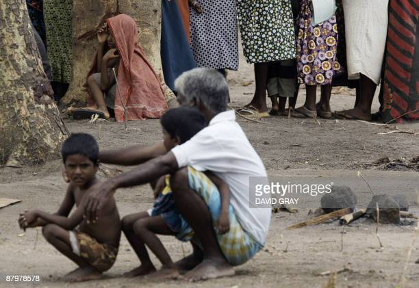 Tamil civilians queue for food at the Manik Farm refugee camp located on the outskirts of the northern Sri Lankan town of Vavuniya on May 26 2009 UN...