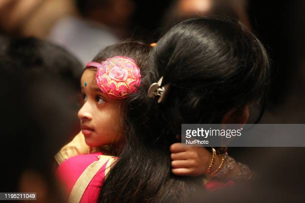 Tamil girl holds onto her mother during a cultural program celebrating the Thai Pongal Festival in Markham Ontario Canada on January 12 2020 The...