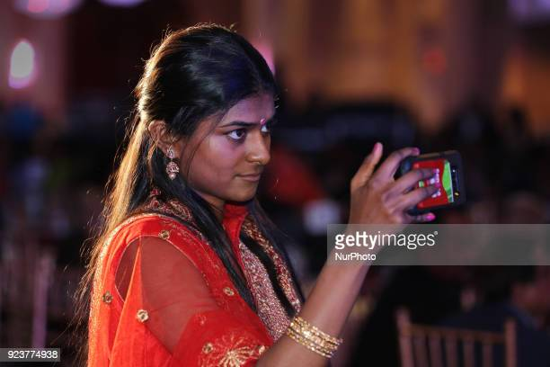 Tamil girl records a video on her mobile phone as Super Singer Jessica Judes performs in Toronto Ontario Canada on February 19 2018 Canadian Tamil...