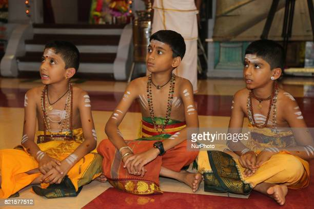 Tamil Hindu boys in training to become Hindu priests listen as a senior priest recites prayers during the Nambiyaandaar Nambi Ustavam Thiruvizha...