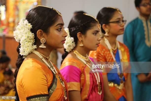 Tamil Hindu children listen to prayers after performing a Bharatnatyam dance during the Nambiyaandaar Nambi Ustavam Thiruvizha pooja at a Hindu...