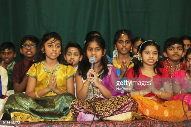 Tamil Hindu children sing prayers honouring Lord Shiva during the Maha Shivratri festival at a Tamil Hindu temple in Ontario Canada on February 13...