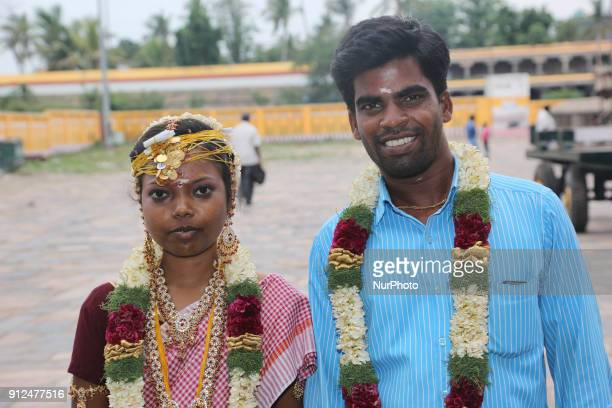 Tamil Hindu couple poses for a photo after just being married at the Nataraja Temple in Chidambaram Tamil Nadu India The Chidambaram Nataraja temple...