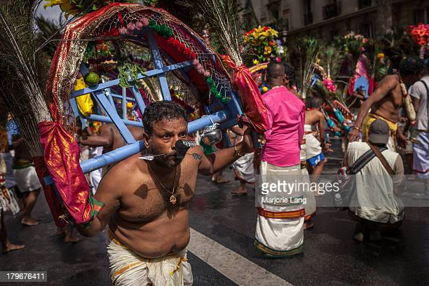 Tamil Hindu devotee dancing in the street at the Ganesha chaturthi festival, celebrating the Hindu god Ganesh birthday, held on September 1st 2013 in...