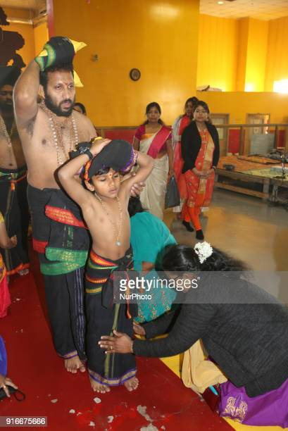 Tamil Hindu devotees are blessed after climbing the pathinettaam padi while they carry coconuts filled with ghee to be offered to Swamy Ayyappa as...