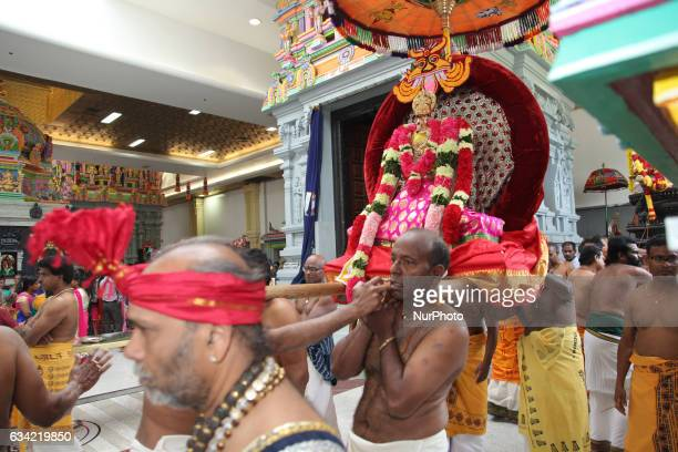 Tamil Hindu devotees carry the idol of Lord Ganesh around the temple during the Murugan Ther Festival at a Tamil Hindu temple in Ontario Canada