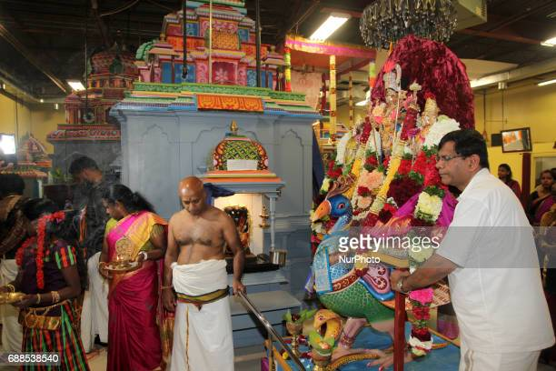 Tamil Hindu devotees escort the idol of Lord Murugan atop a peacock around the temple as part of special prayers during a festival honouring Lord...