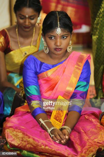 Tamil Hindu devotees listen as special prayers honouring Lord Ganesh are recited during the Sappram Thiruvizha Festival at a Tamil Hindu temple in...