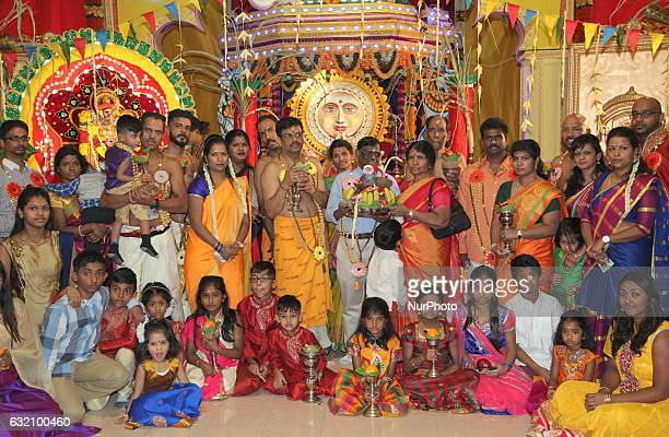 Tamil Hindu devotees pose for a photo after participating in special prayers honoring the Sun God at a Hindu temple in Scarborough Ontario Canada on...