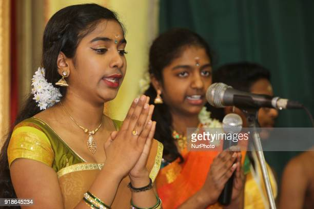 Tamil Hindu girls sing prayers honouring Lord Shiva during the Maha Shivratri festival at a Tamil Hindu temple in Ontario Canada on February 13 2018...