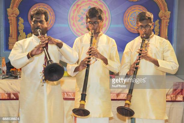 Tamil Hindu musicians perform on the nadaswaram during a festival honouring Lord Murugan at a Tamil Hindu temple in Ontario Canada