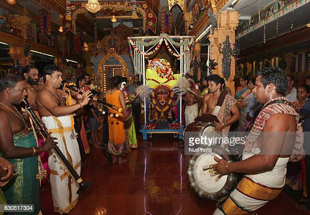 Tamil Hindu musicians playing the Thavil and Naathaswaram lead the procession during the Valvettithurai Athivairawar Festival at a Hindu Temple in...