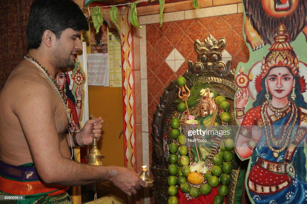 Tamil Hindu priest performs morning prayers at a Tamil Hindu