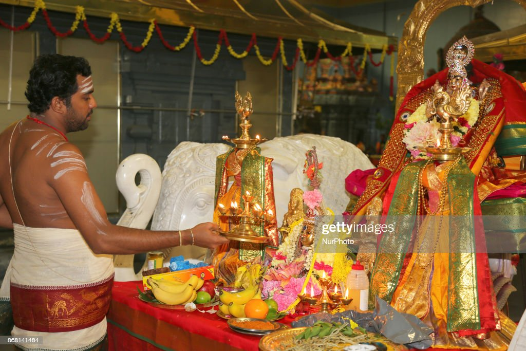 tamil hindu priest performs special prayers during
