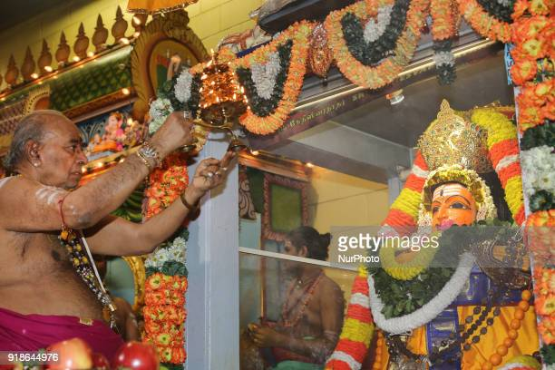 Tamil Hindu priest performs special prayers honouring Lord Shiva during the Maha Shivratri festival at a Tamil Hindu temple in Ontario Canada on...